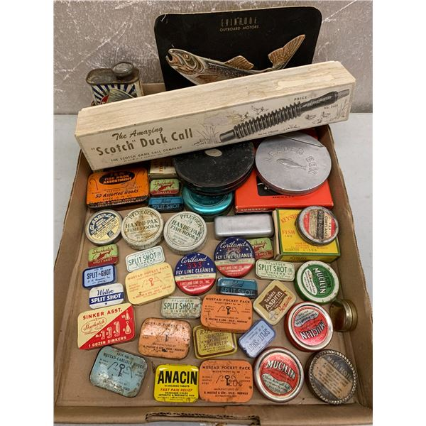 Box of assorted vintage fishing tin collectibles