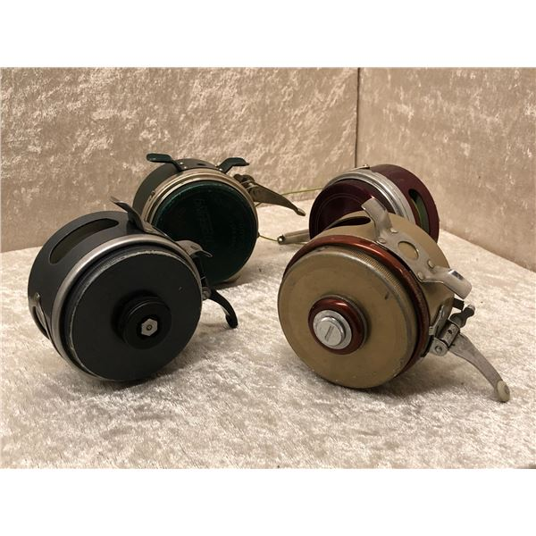 Group of 4 assorted vintage automatic fly reels