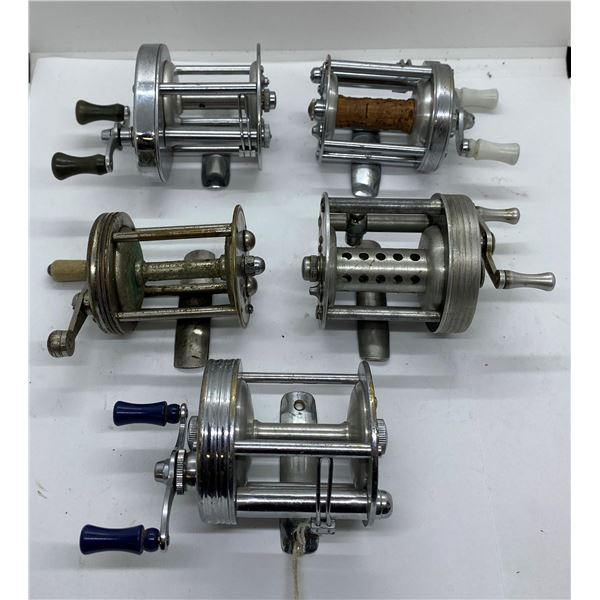 Group of 5 assorted bait cast level-wind bate cast reels