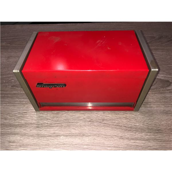 Snap-on mini metal tool cabinet 8 1/2 in. across by 4 1/2 wide stands 4 1/2 in. tall