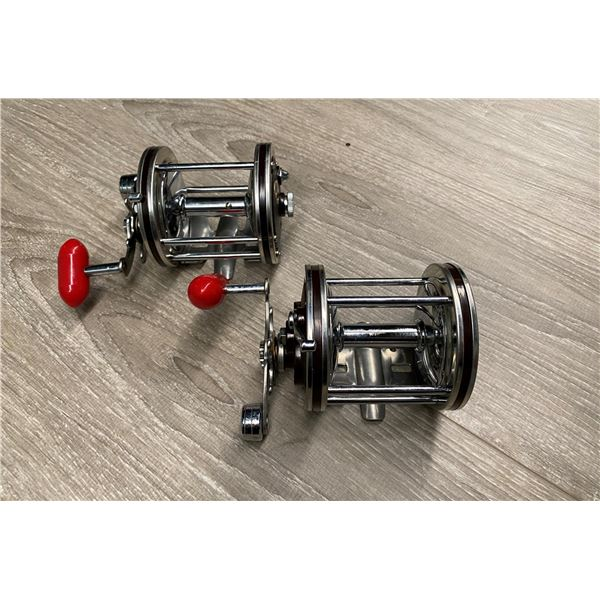 Pair of Immec 140-D level-wind fishing reels - burgundy with red handles