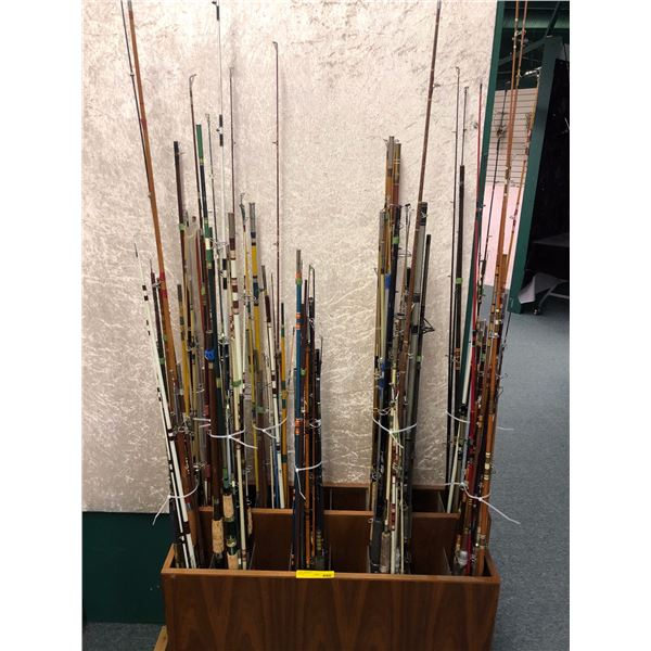 Group of 90 assorted fishing rods (wooden rod display stand not included)
