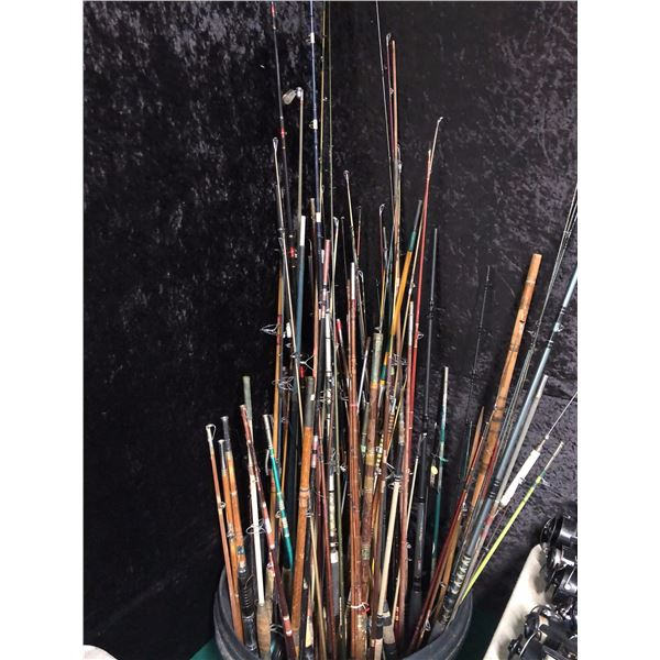 Large black bin filled w/ assorted fishing rods (for parts or repair only)