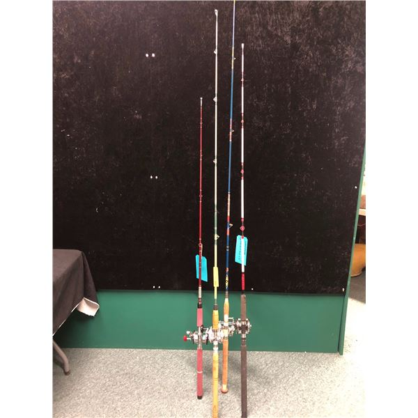 Group of 4 assorted halibut/trolling rods complete with level wind reels