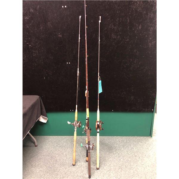 Group of 4 assorted halibut/trolling rods w/ 3 level wind reels & 5in wooden peetz trolling reel