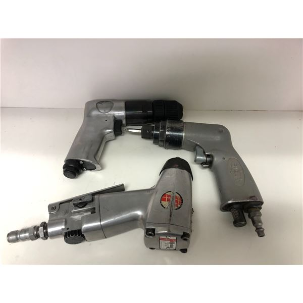 Three assorted pneumatic tools - quarter inch air impact & 2 drills