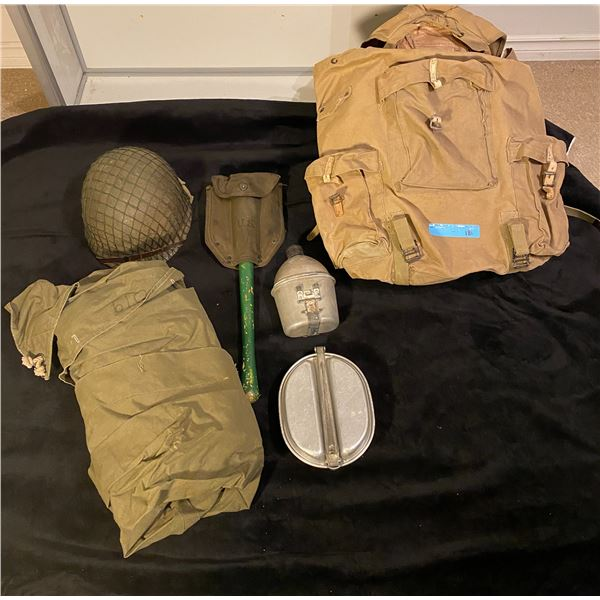 WWll American infantry equipment- including helmet, shovel, canteen, mess kit, shelter half and ruck