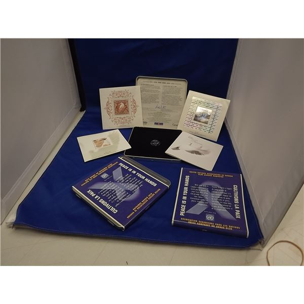 LOT OF 2 1999/2000 CNDN COMMEMORATIVE STAMP PACK - 3 STAMPS & 1 COIN