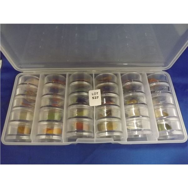 CASE FULL OF POLISHED ROCKS IN DISPLAY CASES