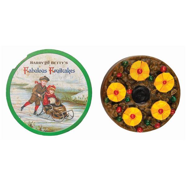 Pair of Jingle Cruise Fruitcake & Tin Props.