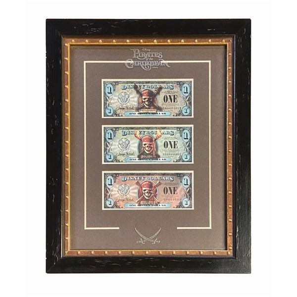 Set of (3) Pirates of the Caribbean Disney Dollars.
