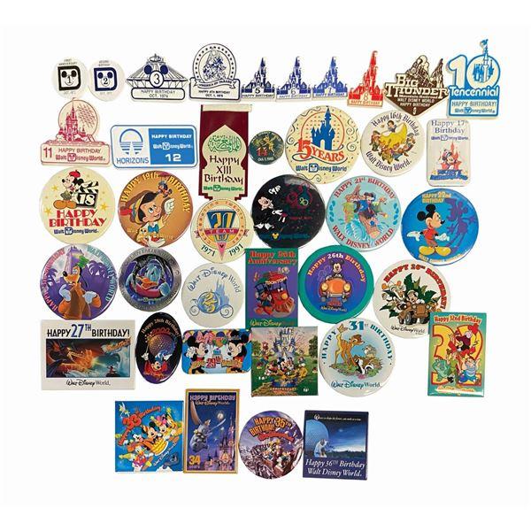 Set of (39) Walt Disney World Park Anniversary Buttons.