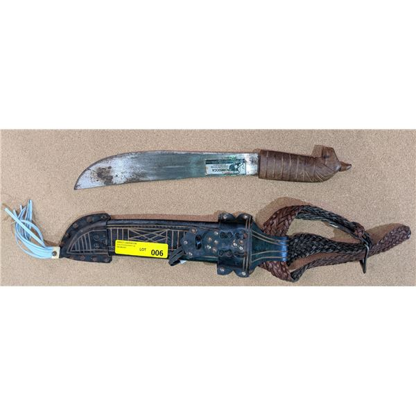 Fancy wood carved handled machete w/leather sheath from the show