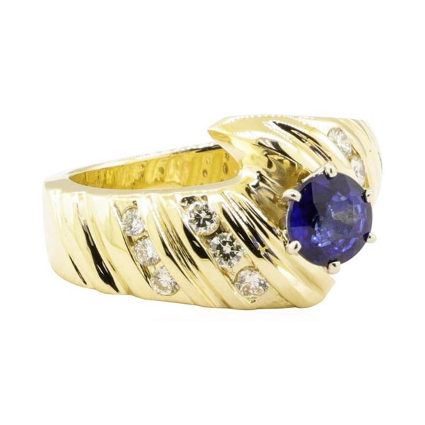 1.20 ctw Blue Sapphire And Diamond Ring - 14KT Yellow Gold