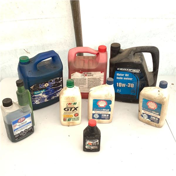 Assortment of Open Containers of Oil
