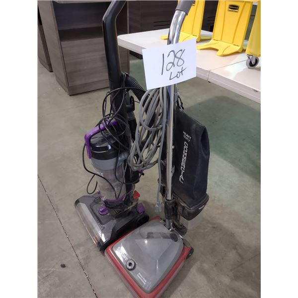 PAIR OF COMMERCIAL GRADE VACUUM CLEANERS, SANITAIRE AND BISSELL
