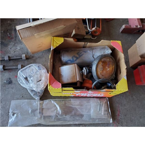 BOX OF ASSORTED TRUCK REPLACEMENT PARTS INCLUDING DOOR HANDLES, FILTERS, DIP STICKS, AND LIGHT