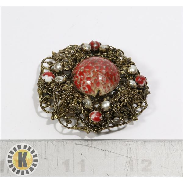 LARGE BALTIC GOLD TONE BROOCH WITH RED STONES