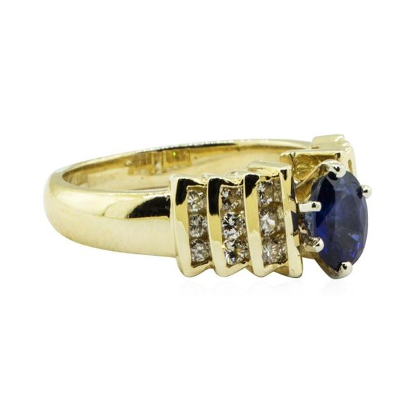 1.30 ctw Oval Brilliant Blue Sapphire And Diamond Ring - 14KT Yellow Gold