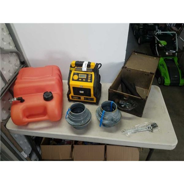 4 METAL DRAINS, THREADED BOLTS, GAS TANK, CAT BATTERY CHARGER AS IS