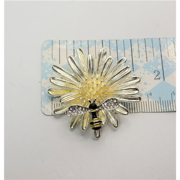 1)  SILVER TONE AND YELLOW & BLACK ENAMEL AND CLEAR CRYSTAL BEE ON FLOWER BROOCH.