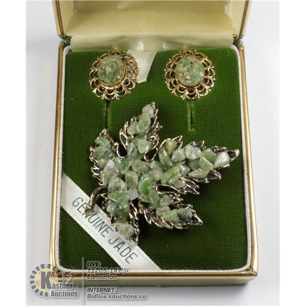 A GOLD MAPLE LEAF WITH CRUSHED JADE AND ONE SET OF CRUSHED