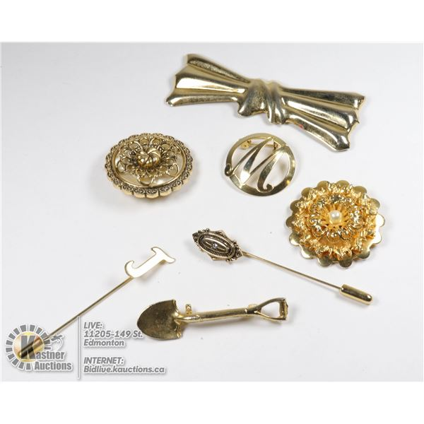 BOX OF ANTIQUE BROOCHES, DRESS CLIPS, AND NECK CUFF PINS