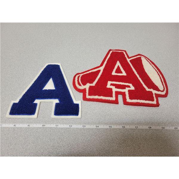 "2 ""a"" felt letters"