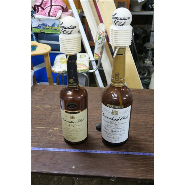 2 Texas Mickey Bottles & Pumps