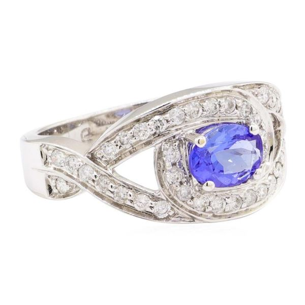 1.22 ctw Oval Mixed Tanzanite And Round Brilliant Cut Diamond Ring - 14KT White