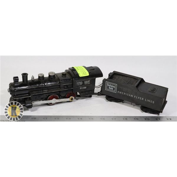 VINTAGE TOY TRAIN WITH A WAGON ATTACHED