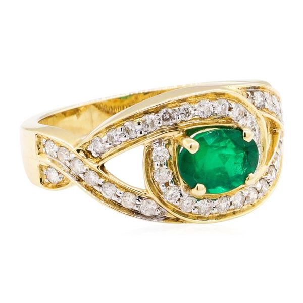 1.35 ctw Oval Mixed Emerald And Round Brilliant Cut Diamond Ring - 14KT Yellow G