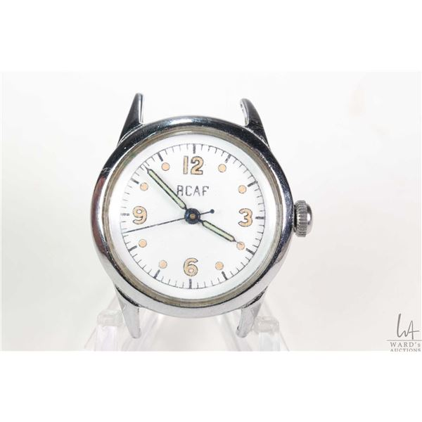 Vintage WWII RCAF aviators watch with chrome plated case and steel back. Waltham Premier hand windin