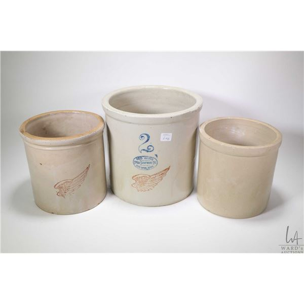 Three stoneware crocks including a two gallon, an unmarked one gallon crock and a one gallon Red Win
