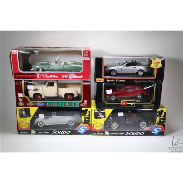 """Six 1:18th scale boxed die cast toys including a 1934 Ford Roadster """"Humphrey Bogart"""", '61 Rolls Roy"""