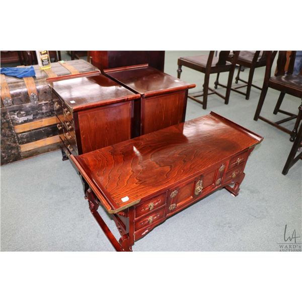 """Set of three Oriental tables, each with multiple drawers including 36"""" X 15"""" coffee table and two si"""