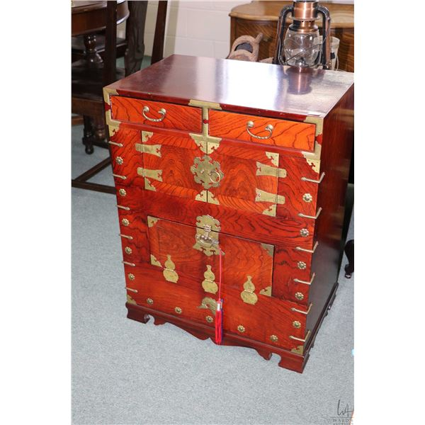 Small Oriental chest with two drawers, double doors section and flip down bottom section plus decora