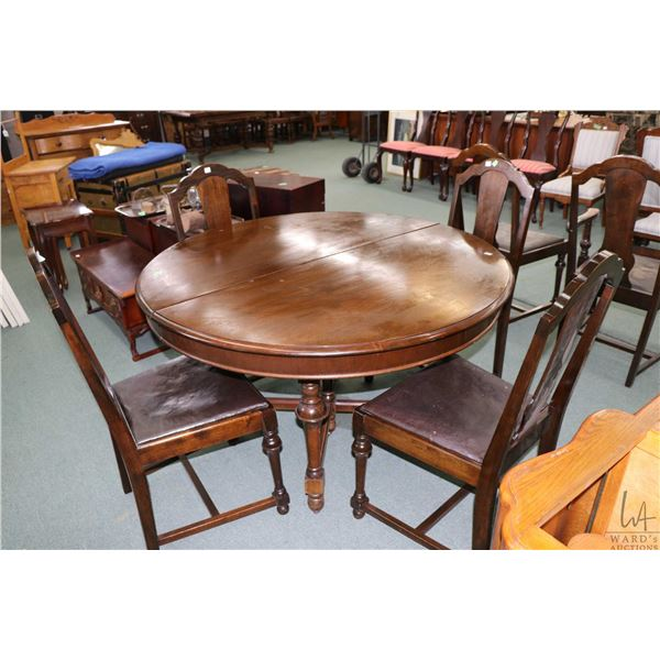 """Mid 20th century 48"""" round dining table with six matching chairs including one carver"""