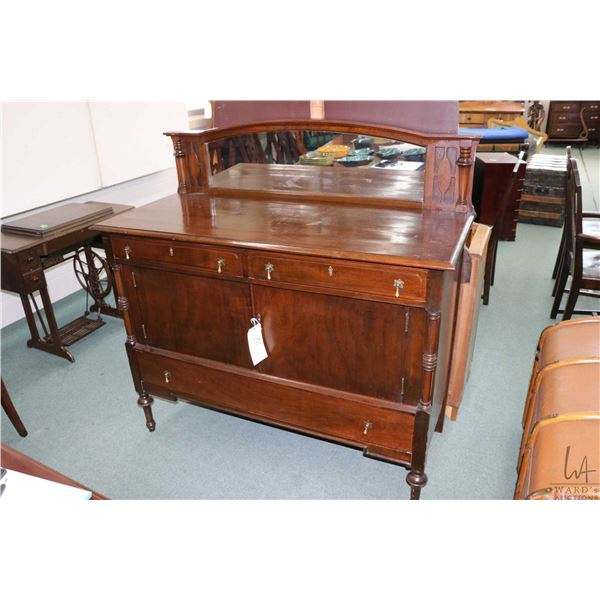 Mid 20th century mahogany sideboard with multiple drawers and two doors, mirrored backboard, appears