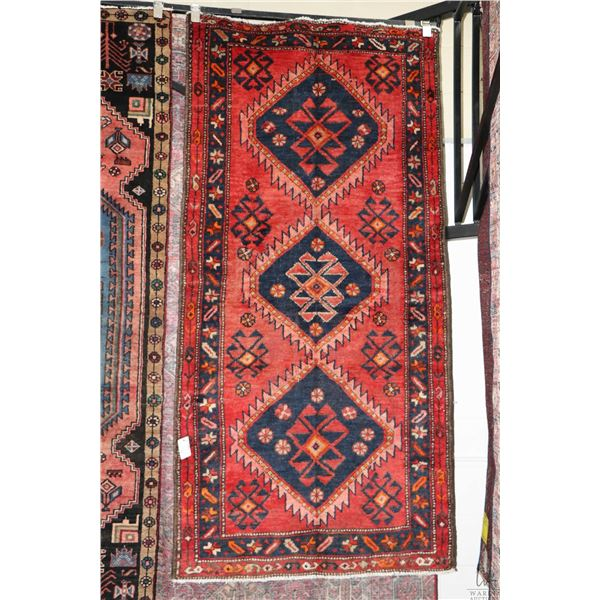 100% Iranian Zanjan area carpet with triple medallion, red background, highlights of blue, orange an