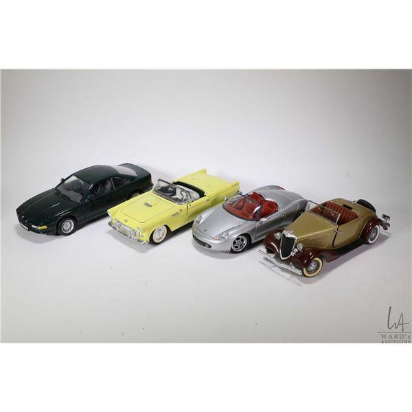 Six 1:18 scale die cast toys including BMW 850i, a '55 Thunderbird, a Porsche Boxster, a Ford V-8, a