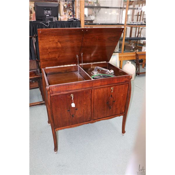 Walnut cased floor standing McLagan hand crank 78 rpm gramophone with fall front door exposing recor