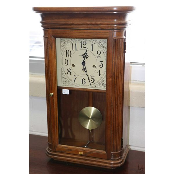 Modern oak cased chiming wall clock with Westminster chime and silent mode switch on face made by Ho