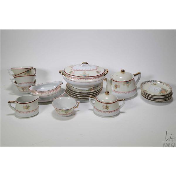 Vintage child's china tea service including teapot, cream and lidded sugar, five teacups and six sau