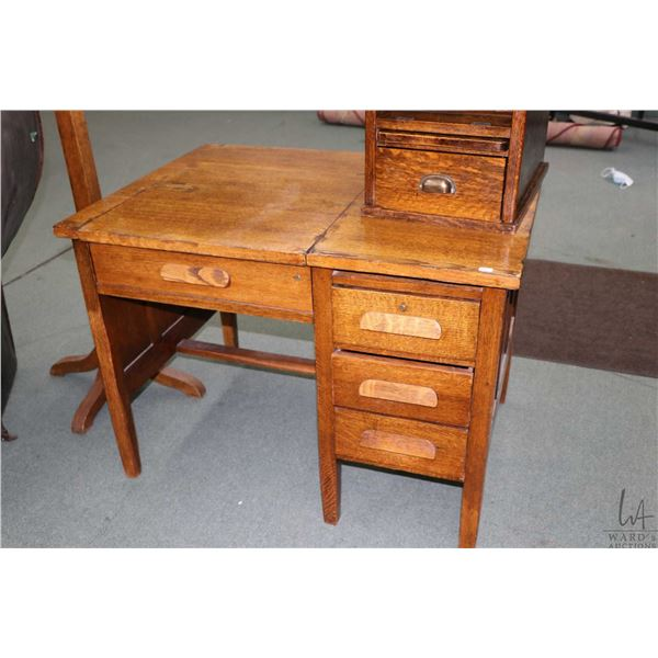 Antique oak single pedestal typist?s desk, note mechanism to hold typewriter is missing and has had