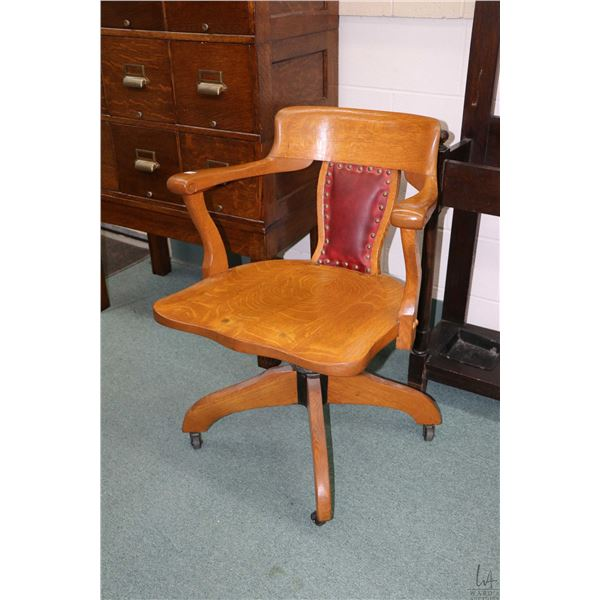 Antique quarter oak swivel office chair, appears refinished with reupholstered back panel