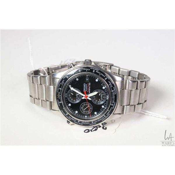 Seiko quartz World Timer Sport 150 wrist watch with stainless bracelet, needing battery, check back