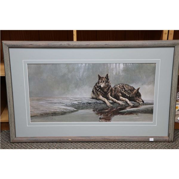 Two framed limited edition wolf prints including a lone wolf at rest, pencil signed by artist  Carl