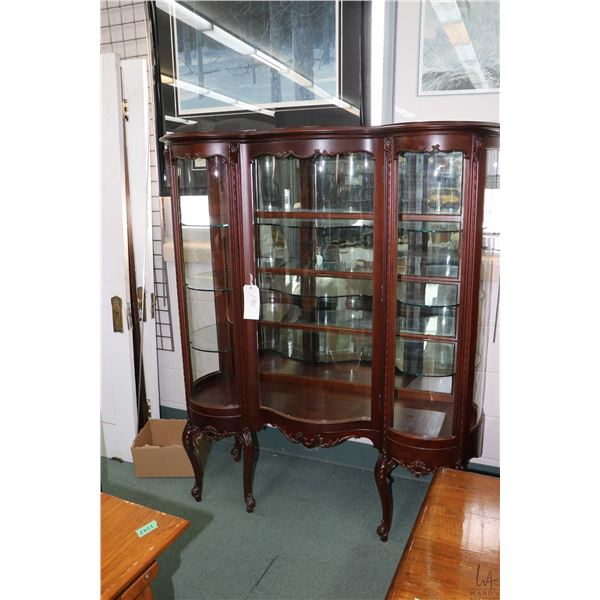 Antique curved glass single door display cabinet with a total of five curved panels, mirrored back a