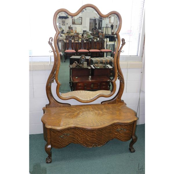 Antique quarter cut oak mirrored low boy with serpentine drawer, sculpted bevelled mirror and carved